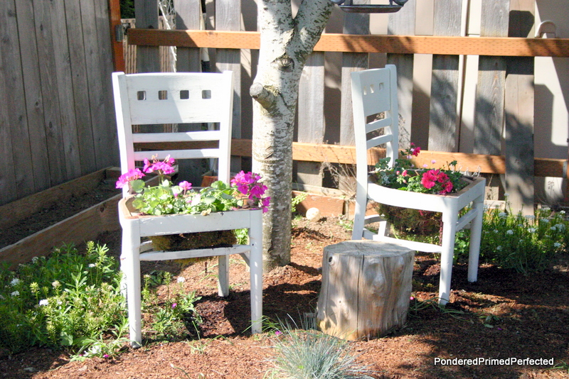 White chairs turned into planters