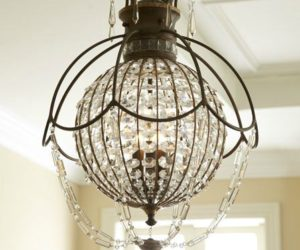 Antique encased chandelier with crystals