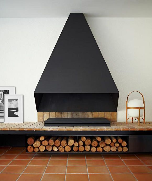 Spanish minimalism interior design with a beautiful fireplace