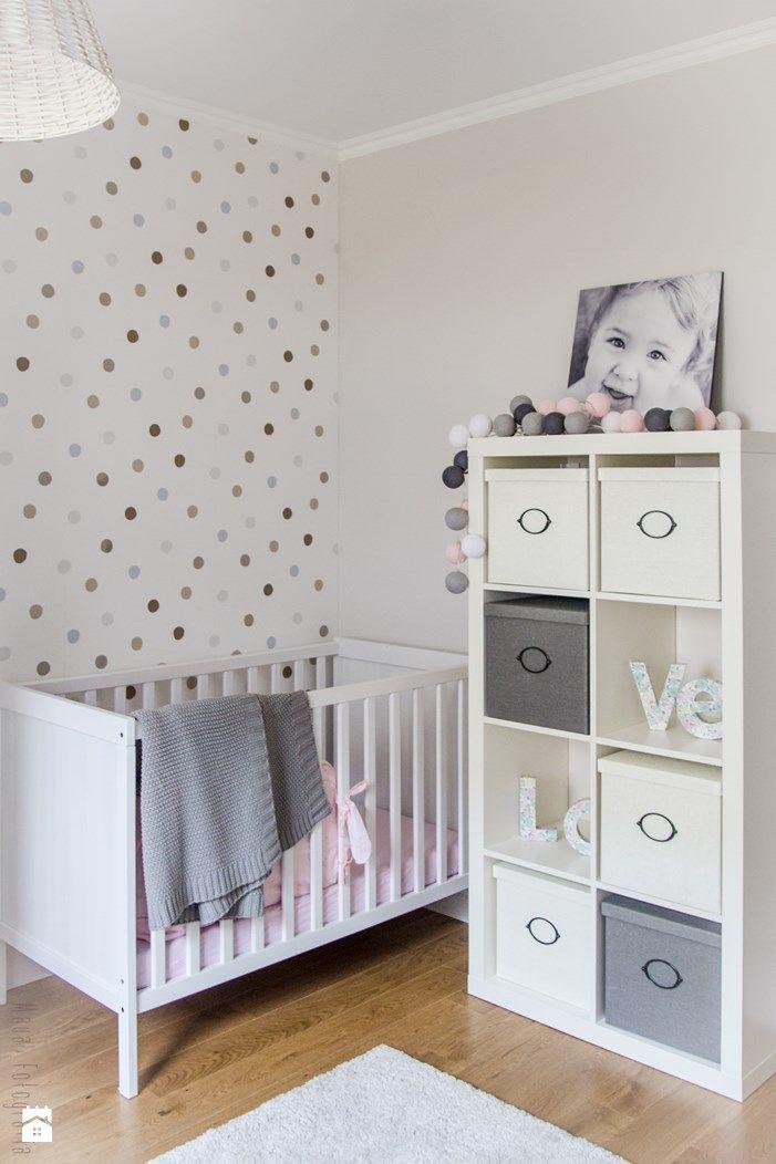 Nursery room with polka dots on wall