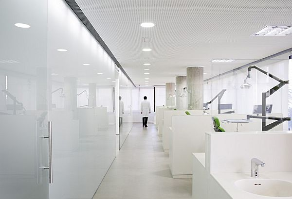 Clean white dental office interior design in spain for Dental office interior design