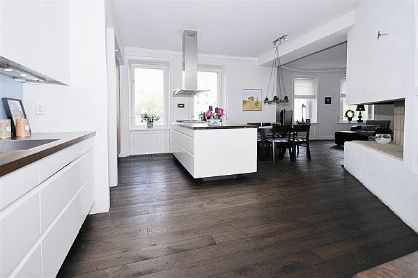 Charming white house in stockholm for Cocina piso madera