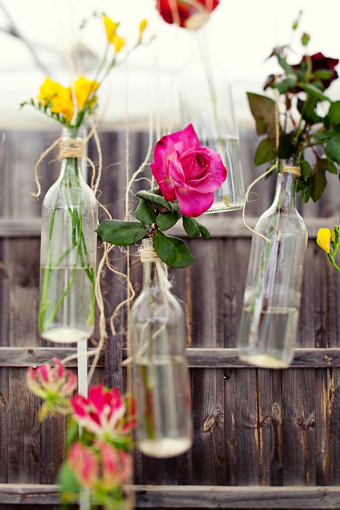 Hanging wine bottles with flowers