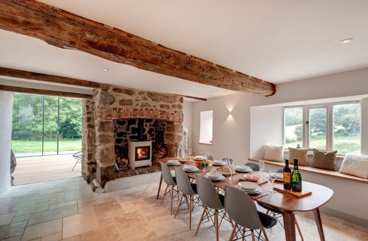 Large wood ceiling beam with a stone fireplace design