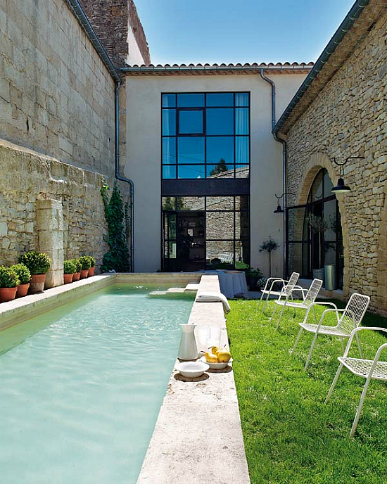 Old Oil Mill Turned Into Family Residence With Backyard Lap Pool
