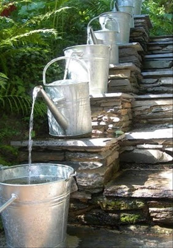 Watering can outdoor water feature
