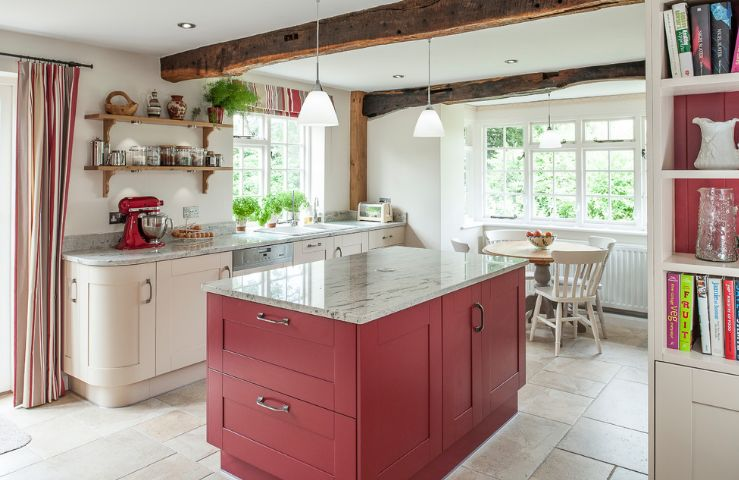 fuschia kitchen design with wooden beams