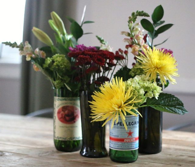 glass bottles turned into flower vases
