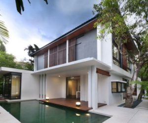Contemporary house designed around two 50 year old mango trees