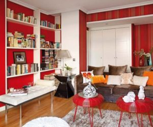 Stylish red attic interior design in Madrid
