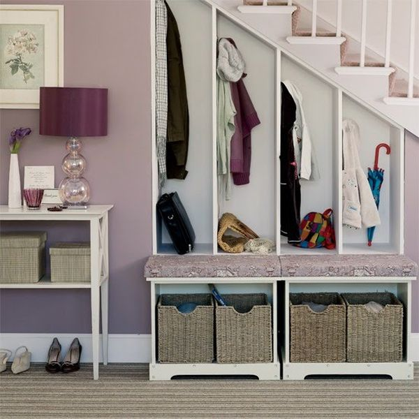 Ways to use the space under the stairs in the hallway.
