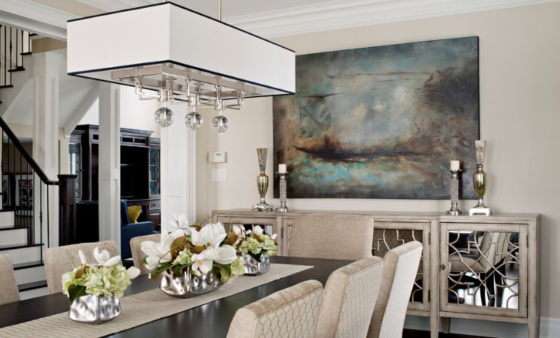 Dining room mirrored sideboard and wall art above