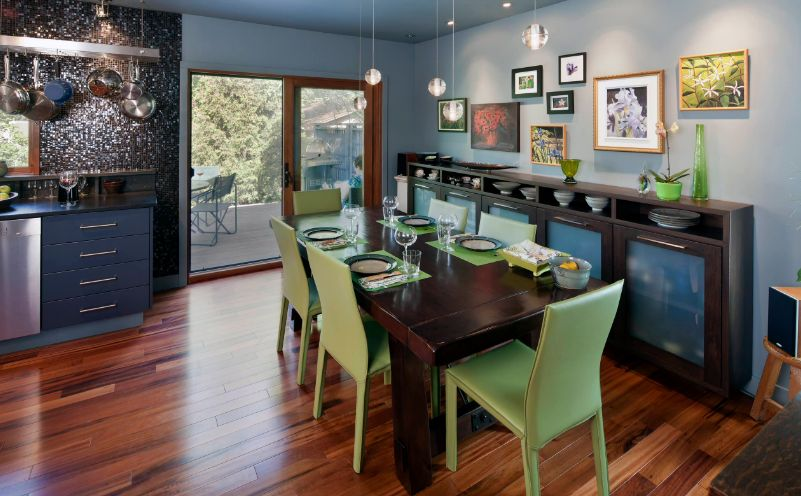 Green dining room chairs and sidebboard with glass doors