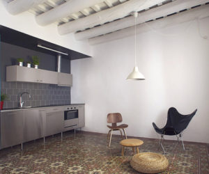 Modern apartment with a mix of mosaic flooring and exposed wooden ceiling beams