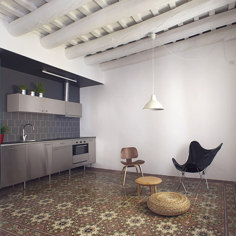 Modern Apartment With A Mix Of Mosaic Flooring And Exposed Wooden Ceiling  Beams Photo Gallery