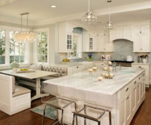 Stylish kitchen with turquoise inserts by Harry Braswell Inc.