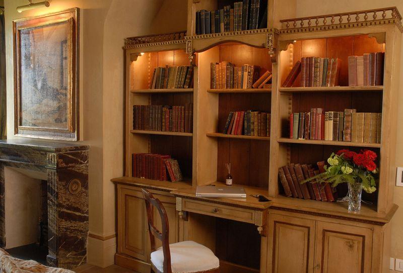 Borgo Santo Pietro hotel antique bookcase
