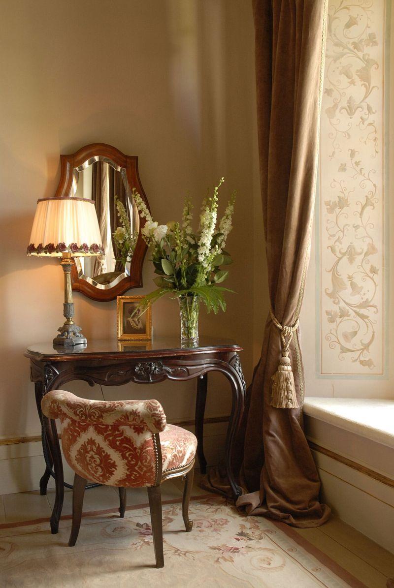 Borgo Santo Pietro hotel antique table