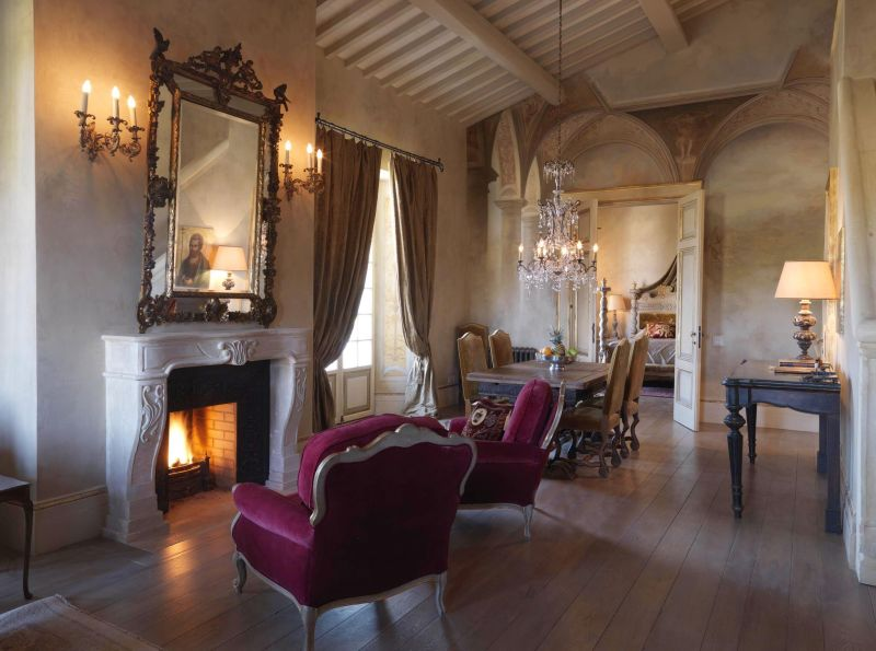 Borgo Santo Pietro hotel bedroom fireplace seats