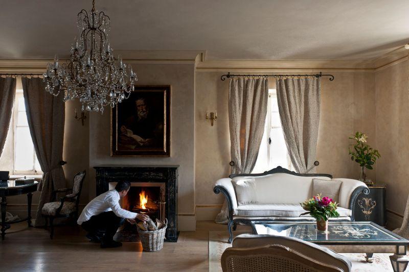 Borgo Santo Pietro hotel bedroom fireplace