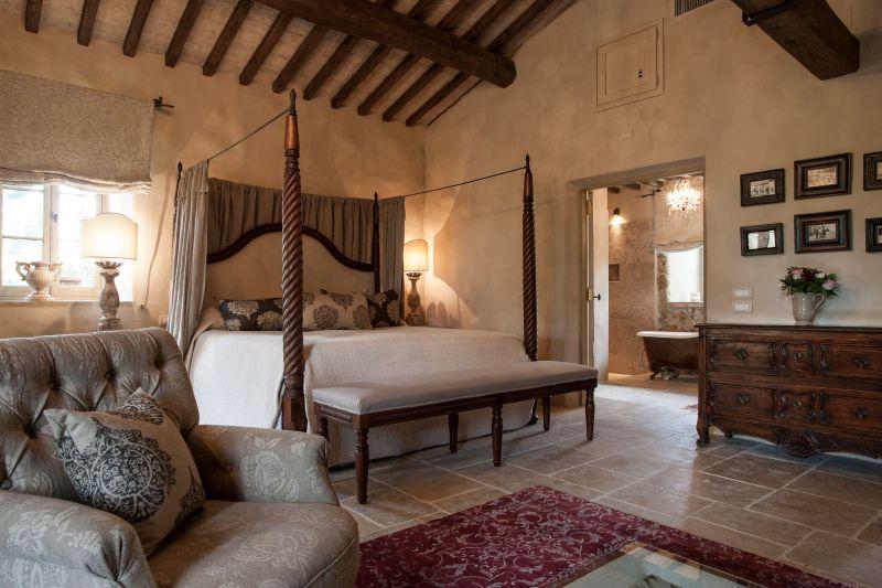 Borgo Santo Pietro hotel bedroom four poster bed