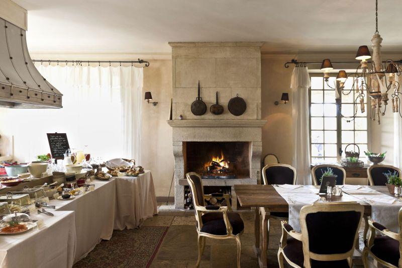 Borgo Santo Pietro hotel dining area open fireplace