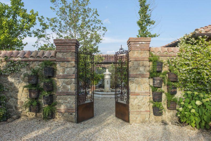 Borgo Santo Pietro hotel entry gate