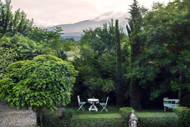 Borgo Santo Pietro hotel garden dining area