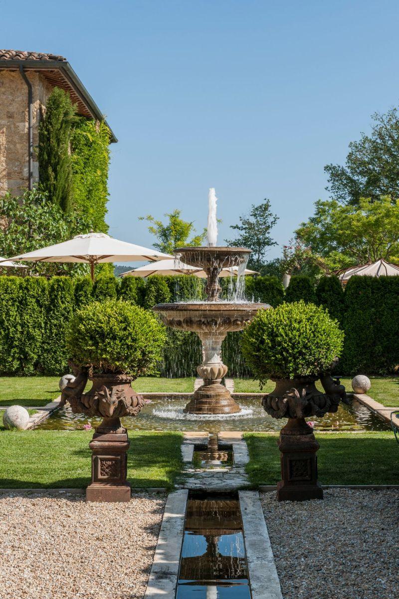 Borgo Santo Pietro hotel garden fountain