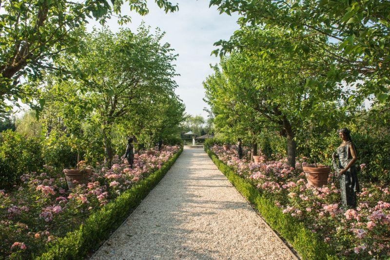 Borgo Santo Pietro hotel garden walkway