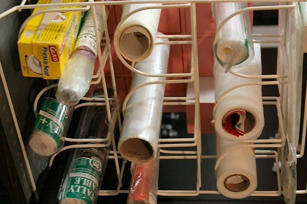 Reorganize Your Plastic Wrap Drawer With A Wine Rack