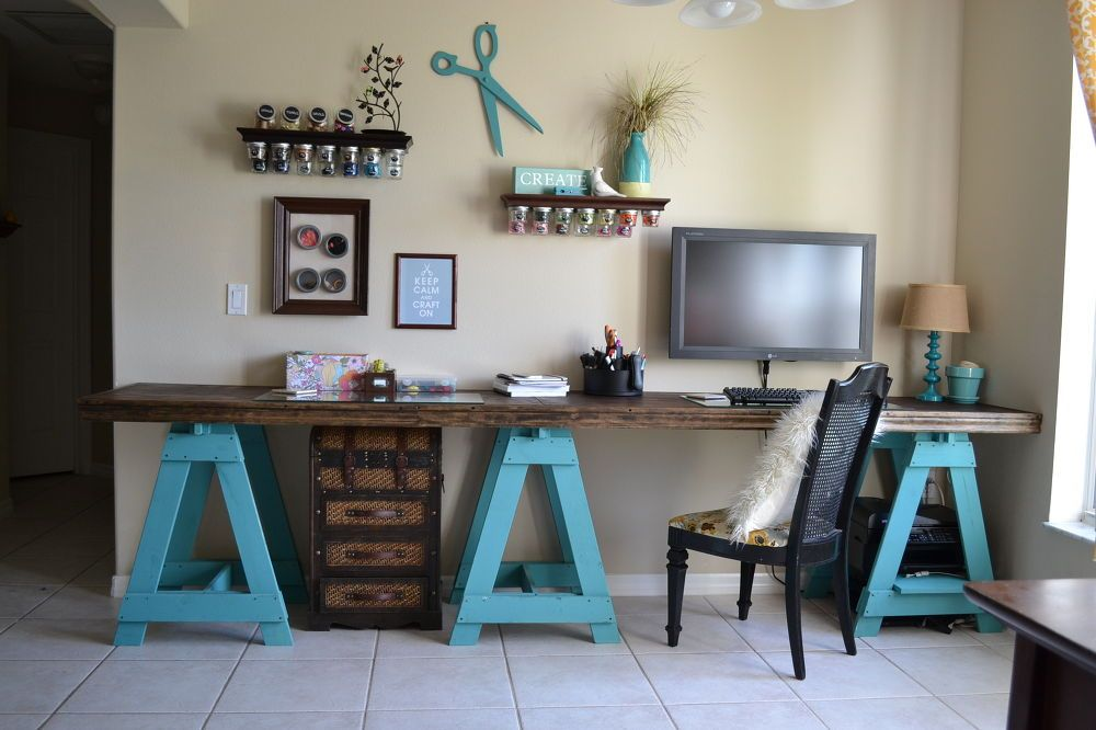 Craft room sawhorse desk with blue base