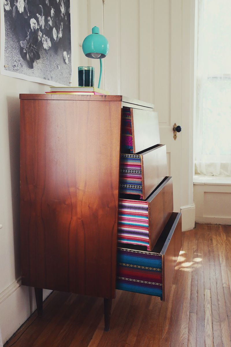 Fabric lined dresser with colorful drawers