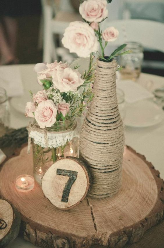 Wedding table centerpiece with wrapped twine bottle
