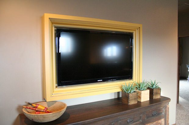 Yellow wall mounted frame tv