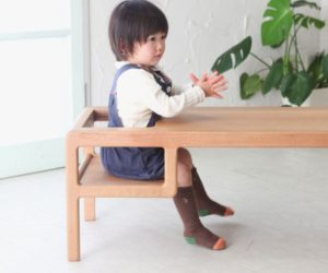 A table with built-in baby seat by Toa Ringyo