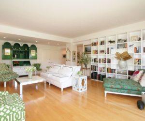 A cozy Los Angeles condo with a green eclectic interior