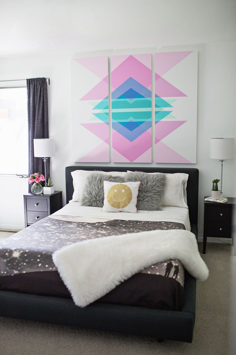 Geometric wall art above headboard