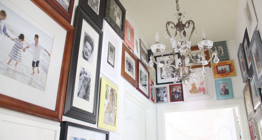 photo wall ideas Hallway Gallery with Mismatched Frames