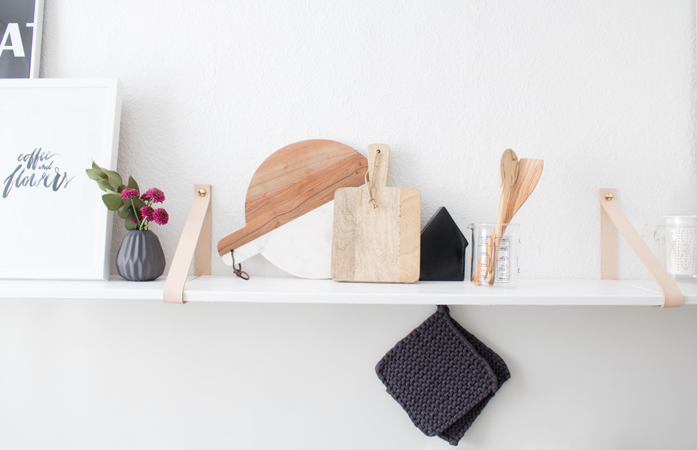 Kitchen shelf with leather straps
