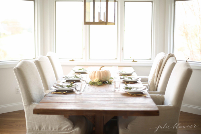 Neutral dining decorated for fall