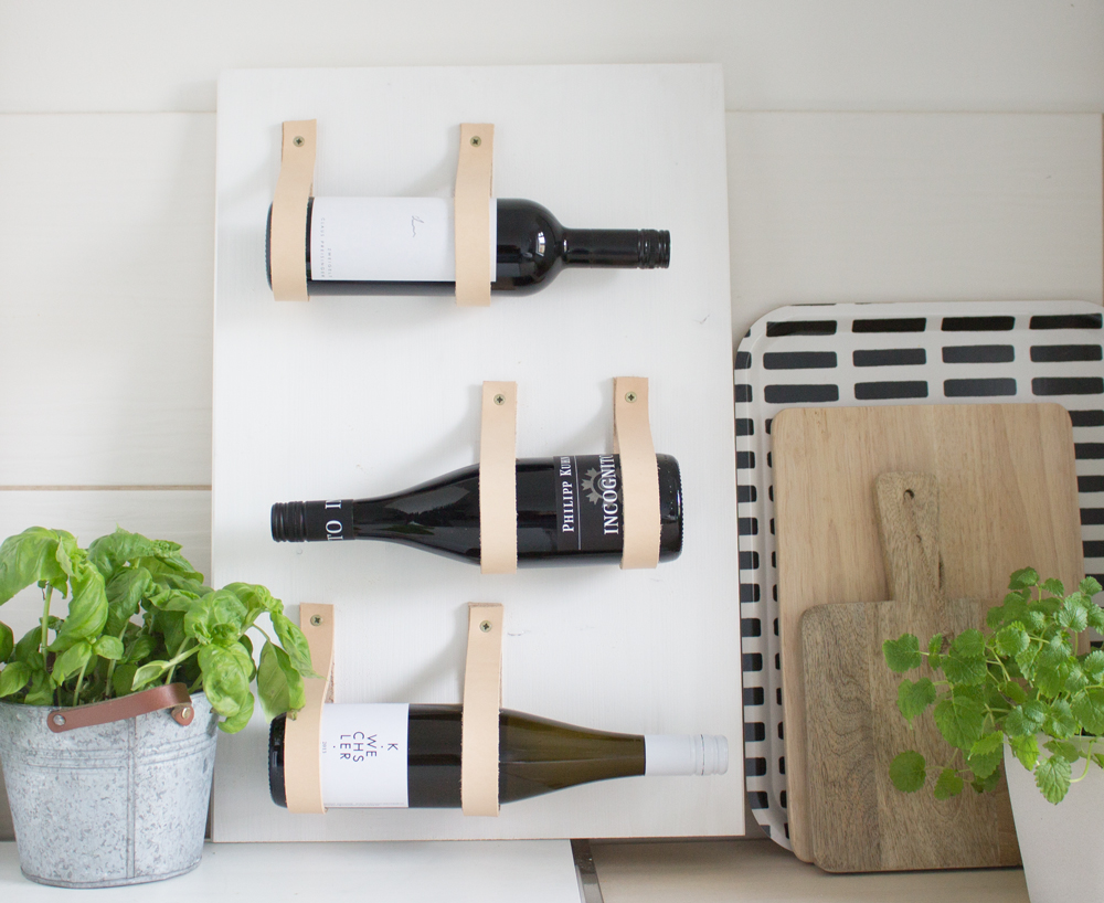Wine rack with leather straps