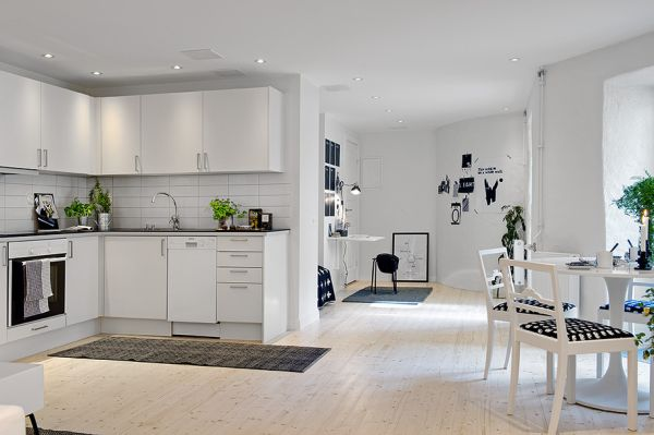 White Apartment a small, white apartment with black accents and modern furniture