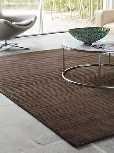 Get A Sandy Look Of Your Living Room With This Wavy Rug