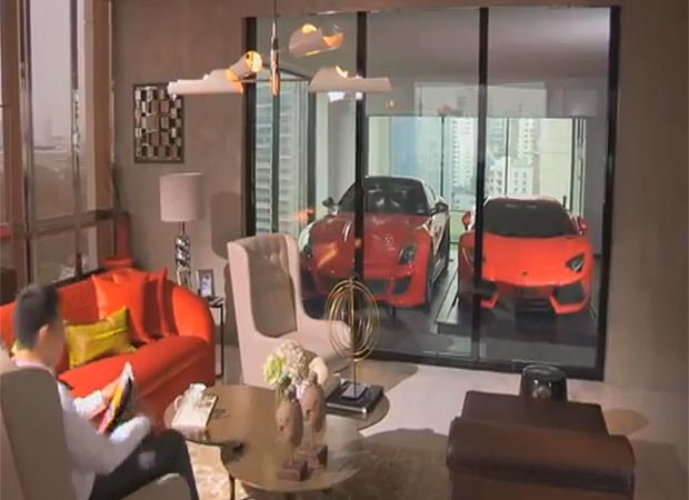 an exclusive apartment block where you can park your car from the living room video. Black Bedroom Furniture Sets. Home Design Ideas