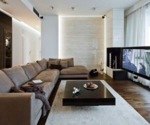 A modern apartment in Poland with a warm interior and an earthy color palette