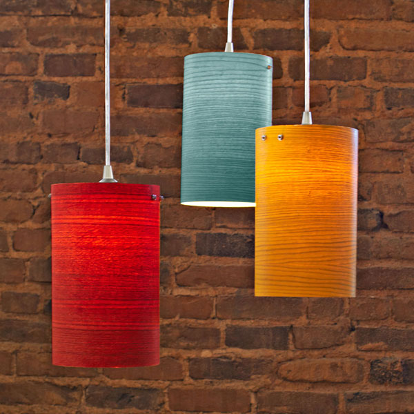 Cylindrical wood veneer pendant lights.
