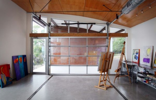 Glass garage door living room - How To Convert A Garage Into A Living Space