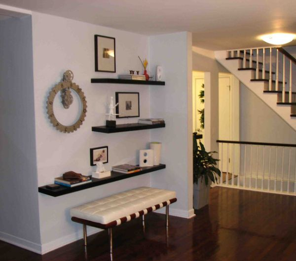 Simple functional and space saving floating wall shelving for Decorating a long wall in a family room