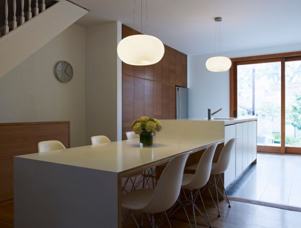 ... Kitchen Island With A Sleek Table And Barstools View ...